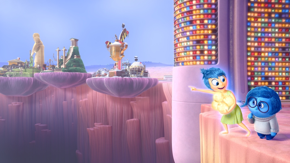 """Joy (voice of Amy Poehler) and Sadness (voice of Phyllis Smith) must venture through Long Term Memory to find their way back to Headquarters in Disney•Pixar's """"Inside Out"""" — in theaters June 19, 2015. ©2015 Disney•Pixar. All Rights Reserved."""